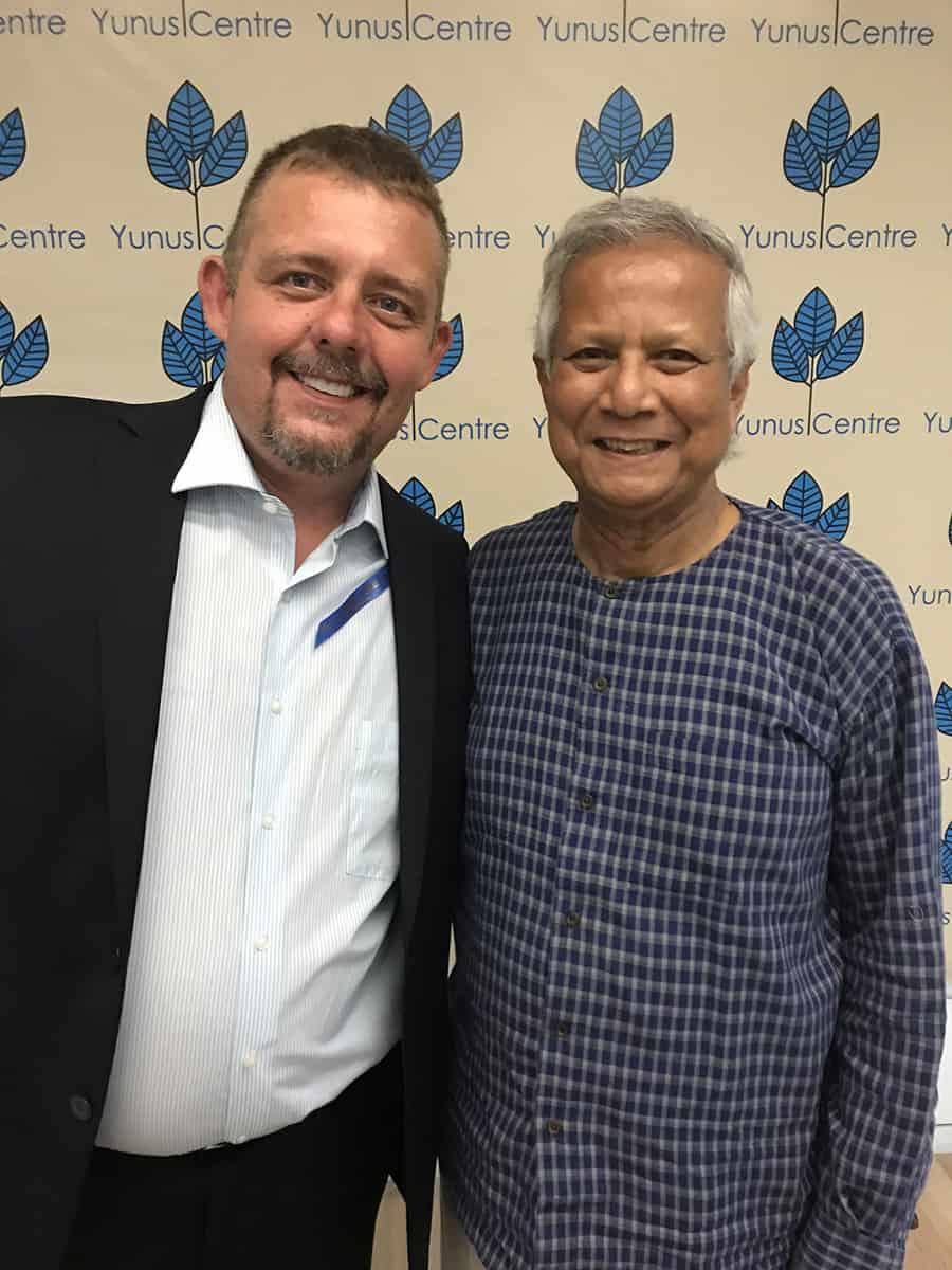 Tim Johnson With PROFFESOR MUHHAMAD YUNIS NOBEL PEACE PRIZE WINNER